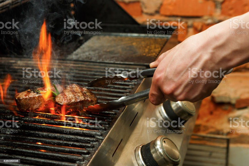 https://media.istockphoto.com/photos/man-cooking-meat-steaks-on-professional-grill-outdoors-picture-id836589598?k=6&m=836589598&s=612x612&w=0&h=k28Cj5aUpnEfdvRZM3onTRUM2Gp_-cau_sn8Hs3uf6Y=