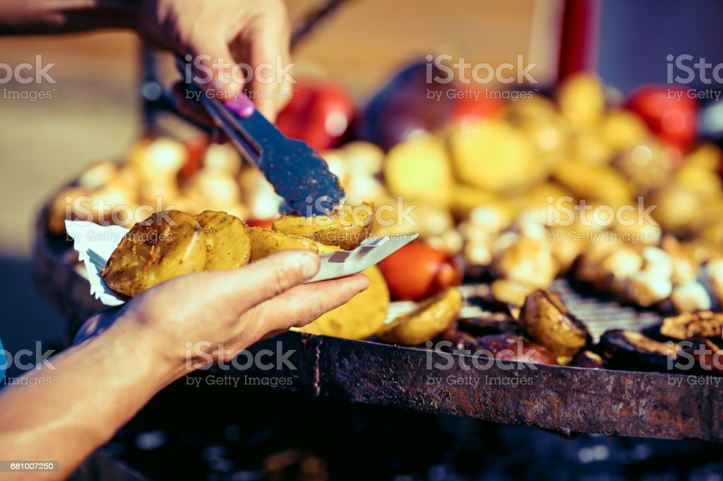 Man cooking on barbecue for family dinner royalty-free stock photo