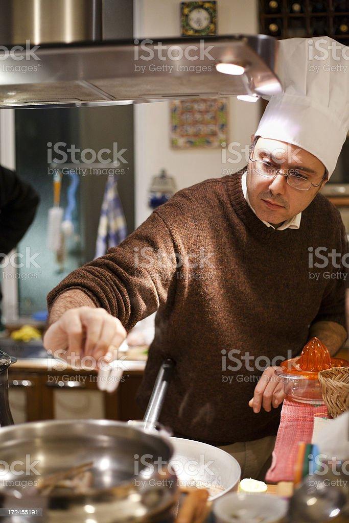 Man cooking seafood. stock photo