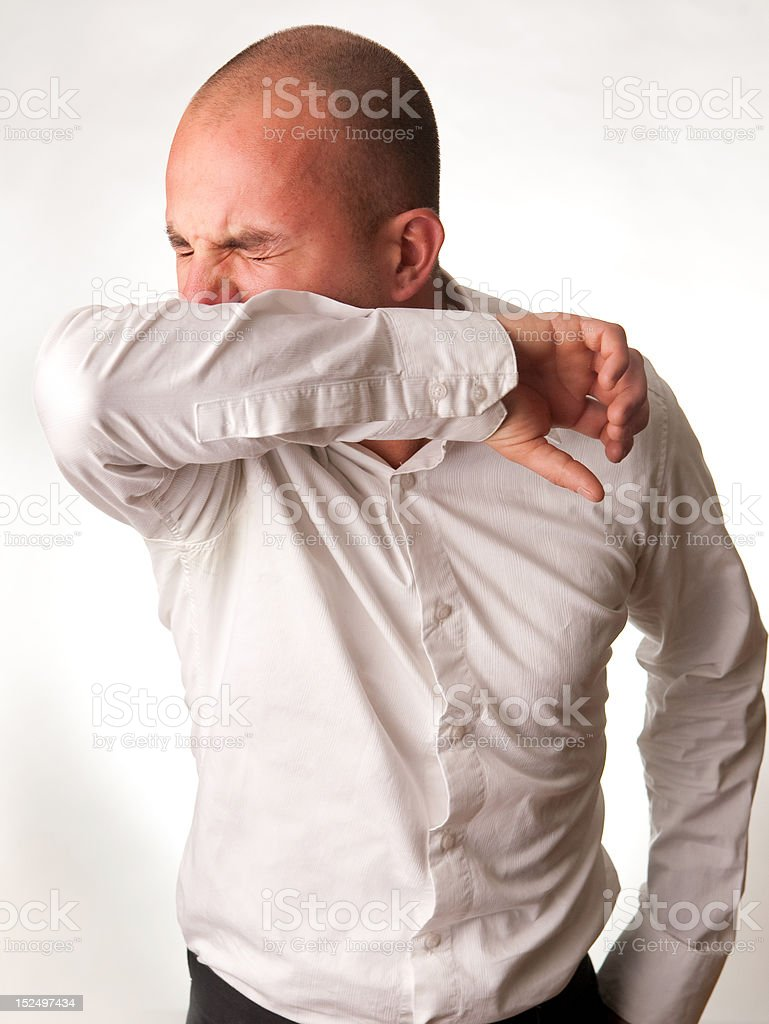 Man Coughing into Arm/Elbow stock photo
