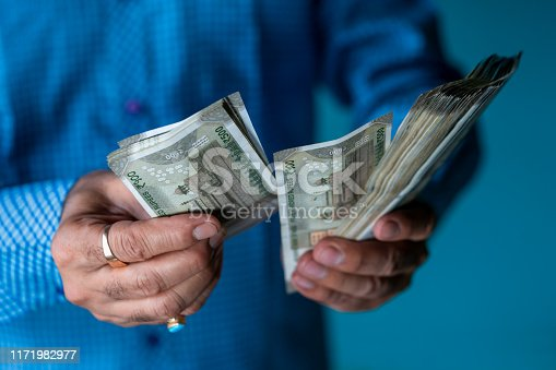 istock Man Counting Indian 500 Rupee Notes 1171982977