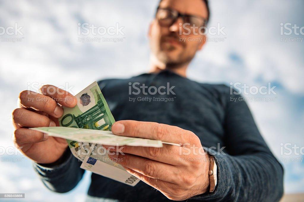 Man counting money stock photo