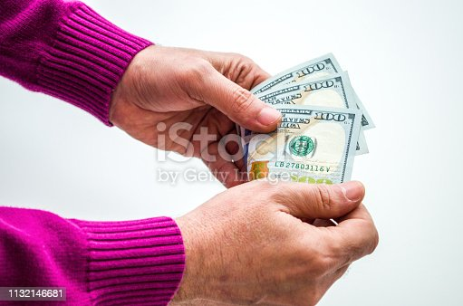 Man counting Us Dollars in hand on white background