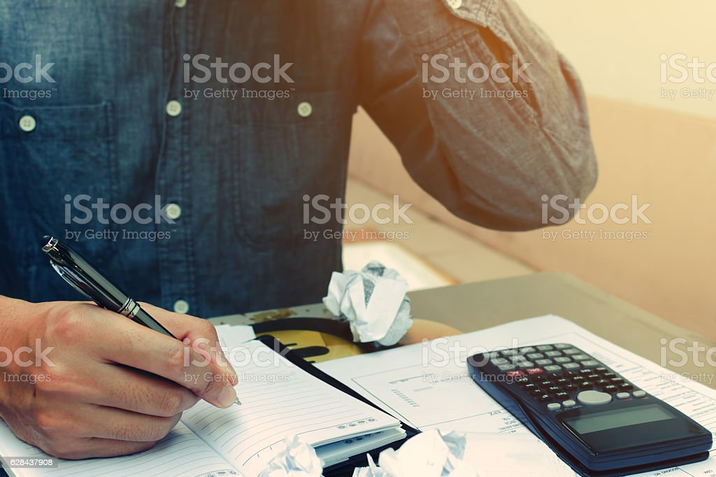 Man counting using calculator and stress in problem with expenses stock photo