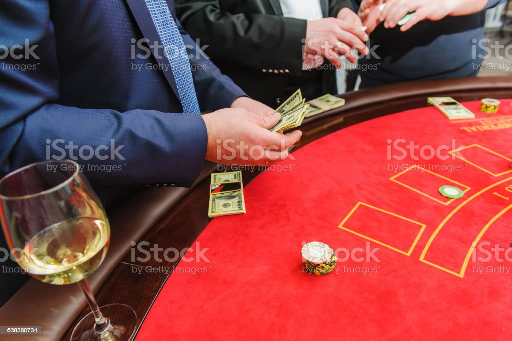 Man counts the money in the casino stock photo