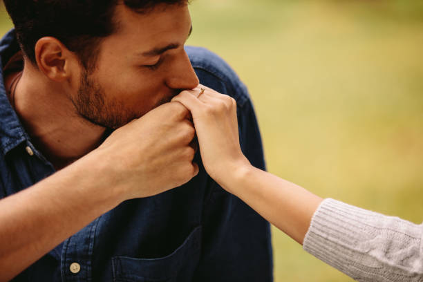 Man courting a woman Close up of a young man kissing woman's hand. Boyfriend kiss girlfriend's hand. kissinghand stock pictures, royalty-free photos & images