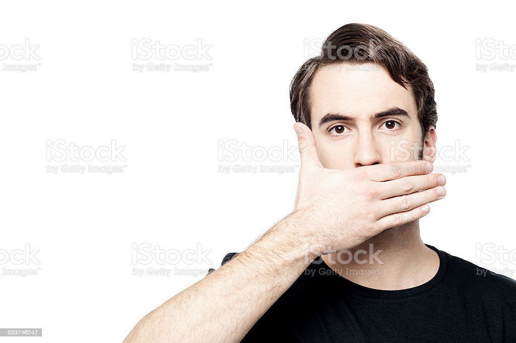 Man cover his mouth,  speak no evil concept. stock photo