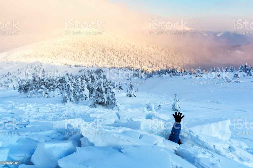 A man covered with a snow avalanche stock photo