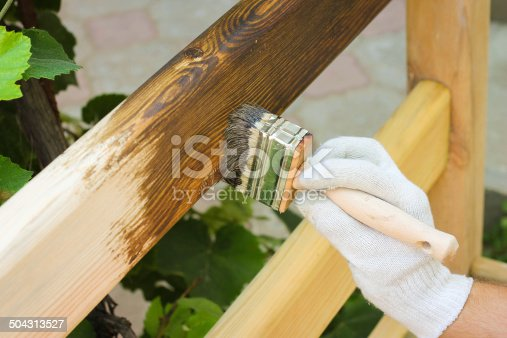istock man covered with lacquer wooden fence 504313527
