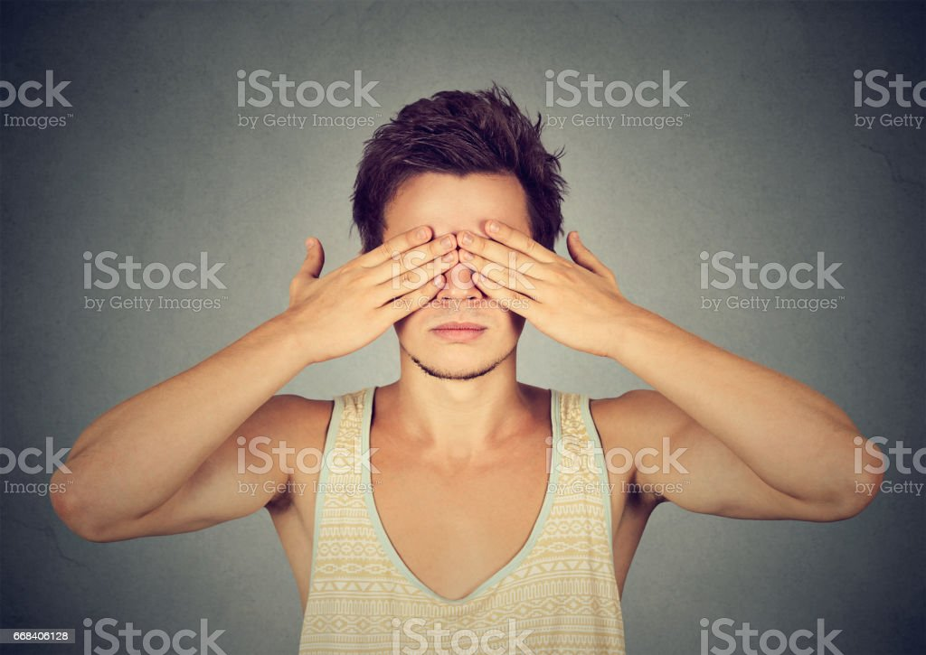 man covering eyes with hands cant see, hiding stock photo
