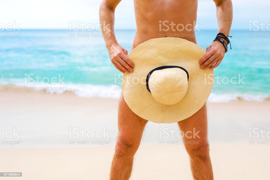 Man covering himself with summer hat stock photo
