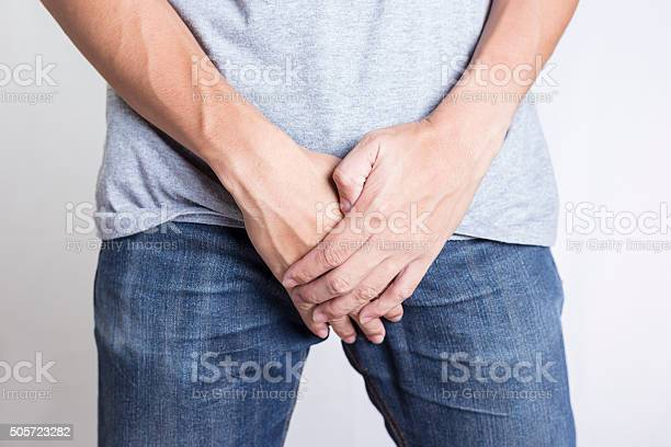 Man Covering His Crotch Isolated Background Stock Photo - Download Image Now