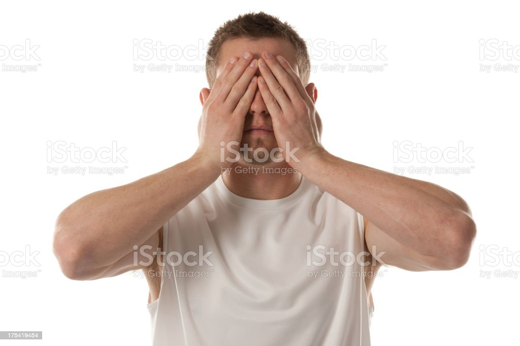 Man covering his eyes with hands stock photo