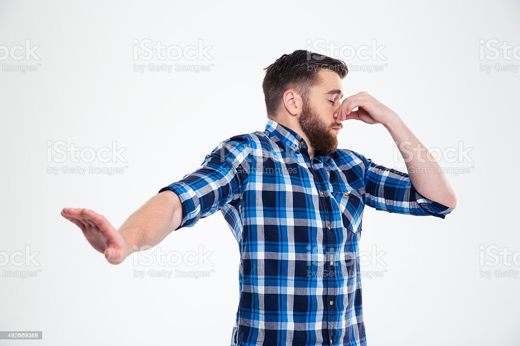 Man covering his nose and showing stop gesture with palm stock photo