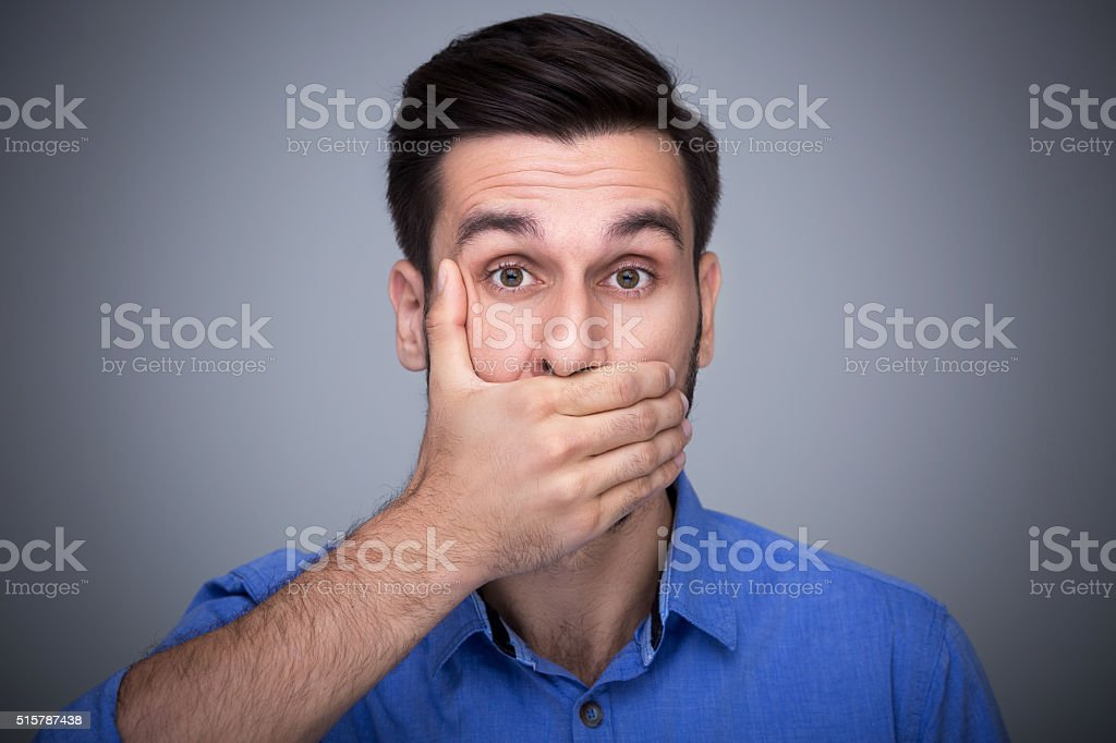 Man covering mouth stock photo