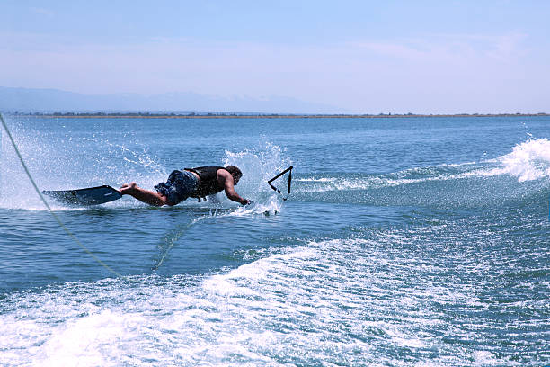 Man Crashes on Wakeboard - End Of The Rope stock photo