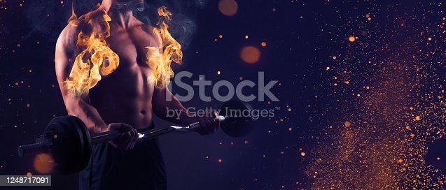 istock Man creating the perfect upper body. Fitness training, bodybuilding and workout concept. 1248717091