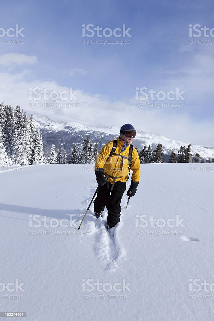 Man Cross Country Skiing in the Mountains royalty-free stock photo
