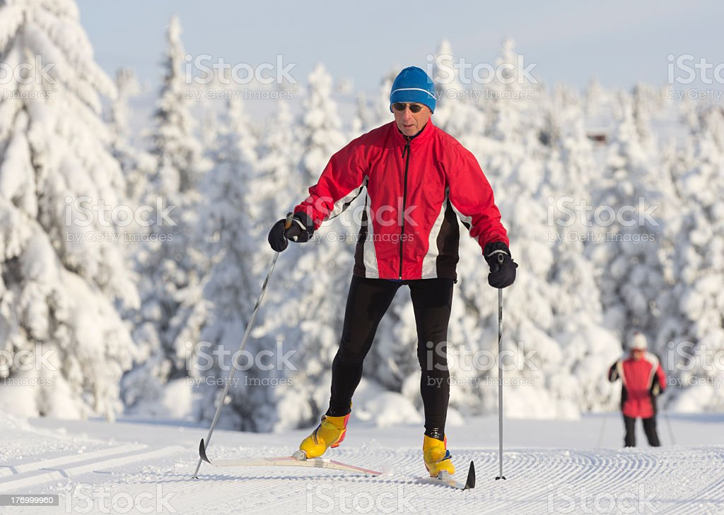 Man cross-country skiing on snow stock photo