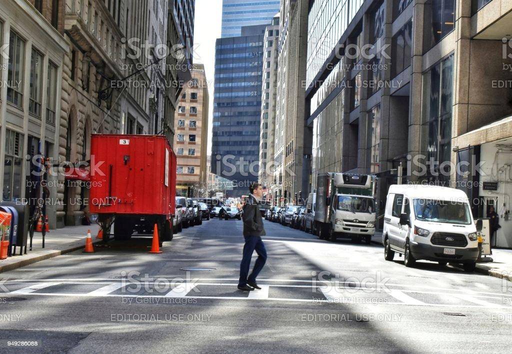 Man Crossing Federal Street, Boston stock photo