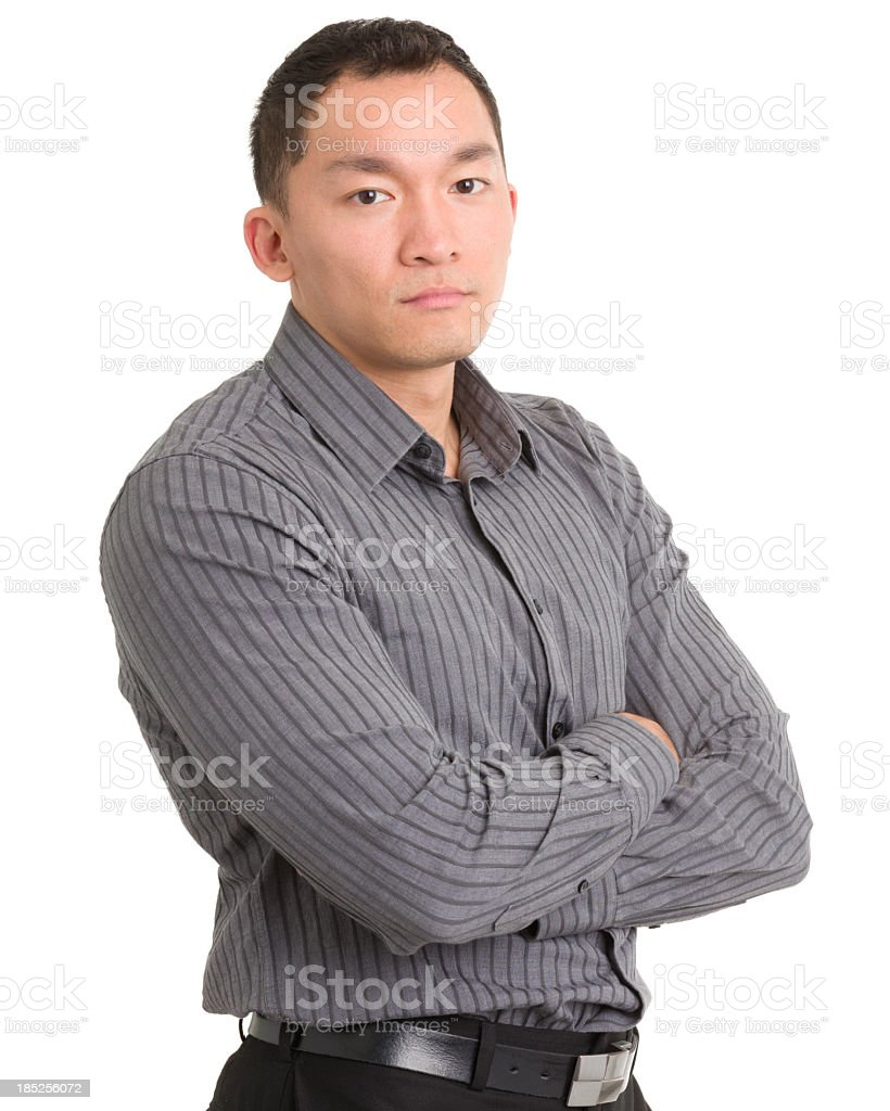Man crossing his arms looking stern royalty-free stock photo