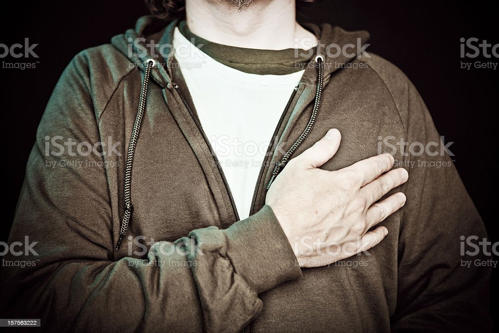A man crossing his chest in patriotic pride stock photo
