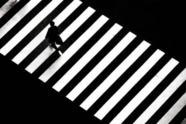 A man crossing zebra crossing in Japan stock photo