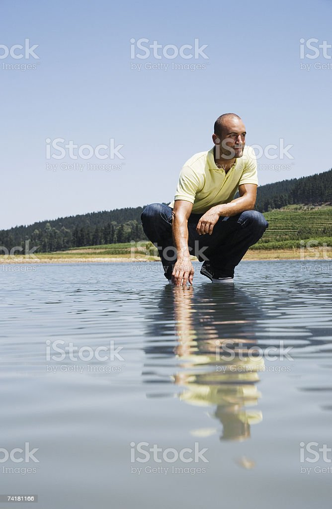 Man crouching on water royalty-free stock photo