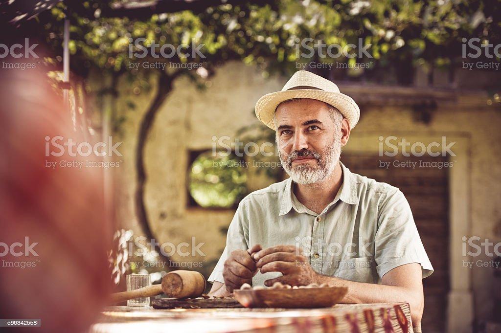 Man Crushing Hazelnuts royalty-free stock photo