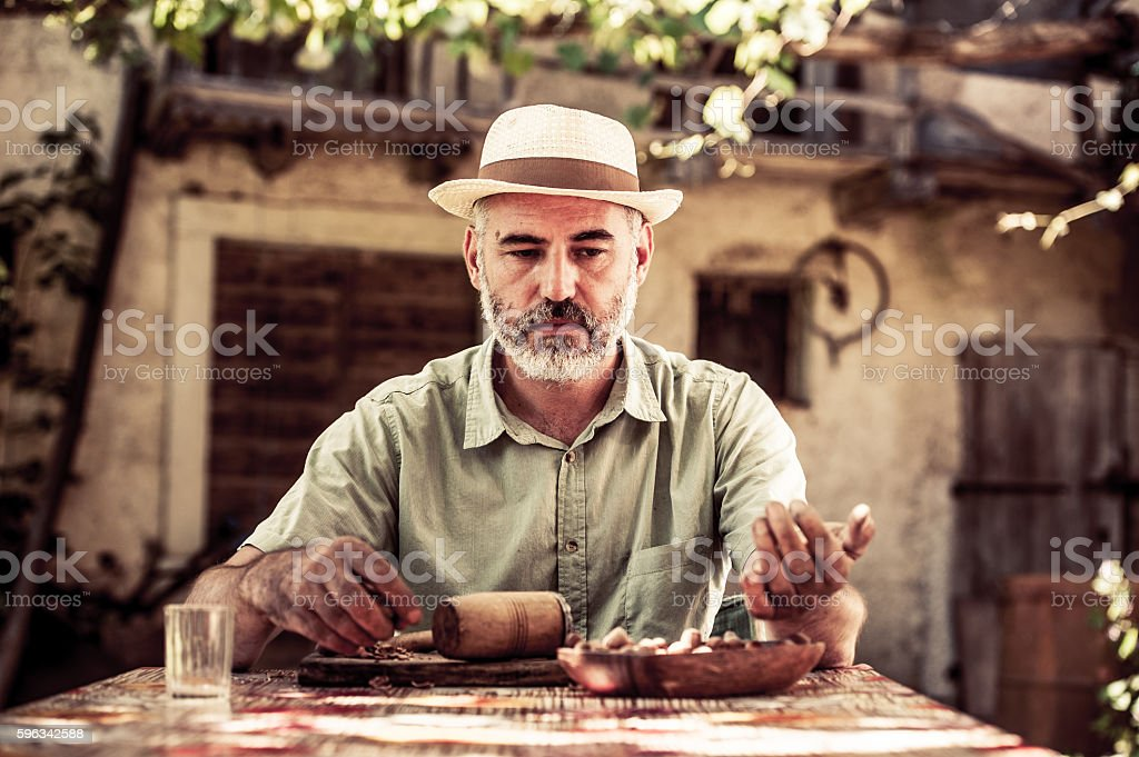 Man Crushing Hazelnuts royalty-free stock photo
