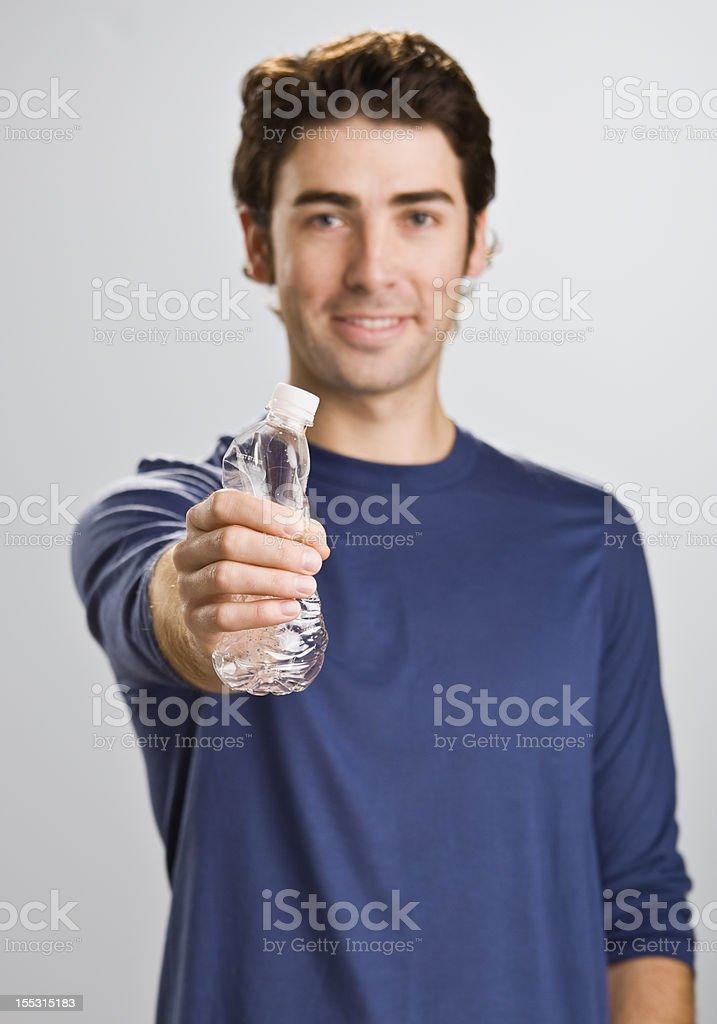 Man Crushing Water Bottle royalty-free stock photo
