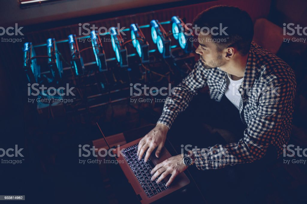 Man cryptocurrency mining stock photo