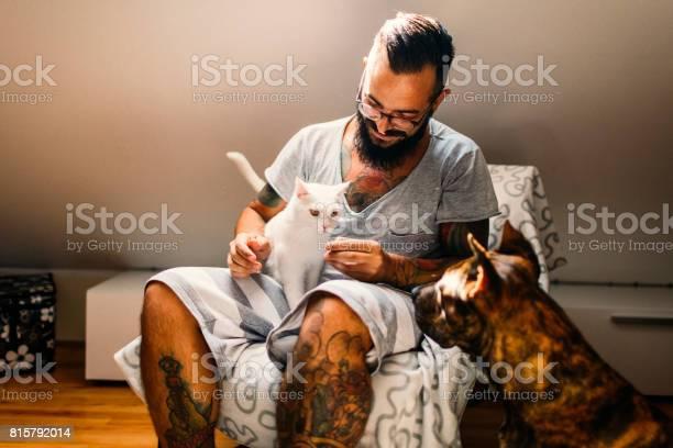 Man cuddling with his cat and his dog picture id815792014?b=1&k=6&m=815792014&s=612x612&h=v0kipclaskz12m4nmuzubk6taiwlidk kige83gizje=
