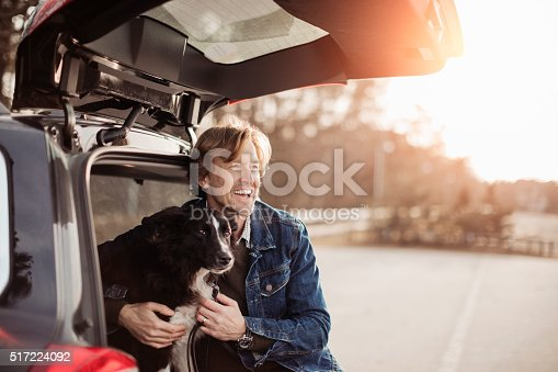 517930062 istock photo Man cuddling with his dog 517224092