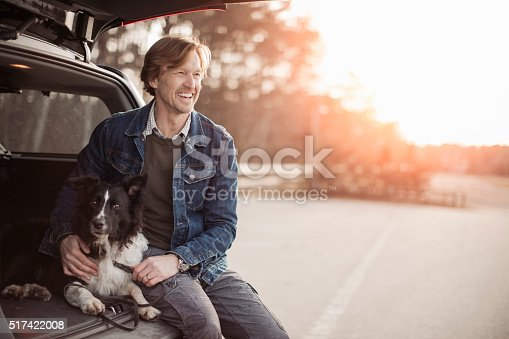 517930062 istock photo Man cuddling with his dog 517422008