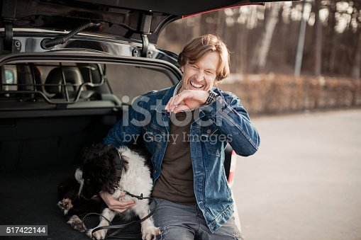 517930062 istock photo Man cuddling with his dog 517422144