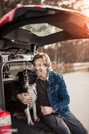 517930062 istock photo Man cuddling with his dog 517458552