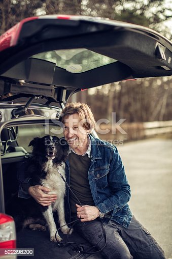 517930062 istock photo Man cuddling with his dog 522398200