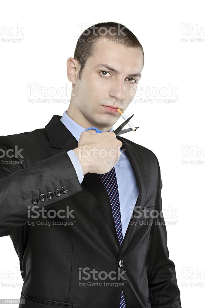 Man cutting a cigarette with scissors royalty-free stock photo