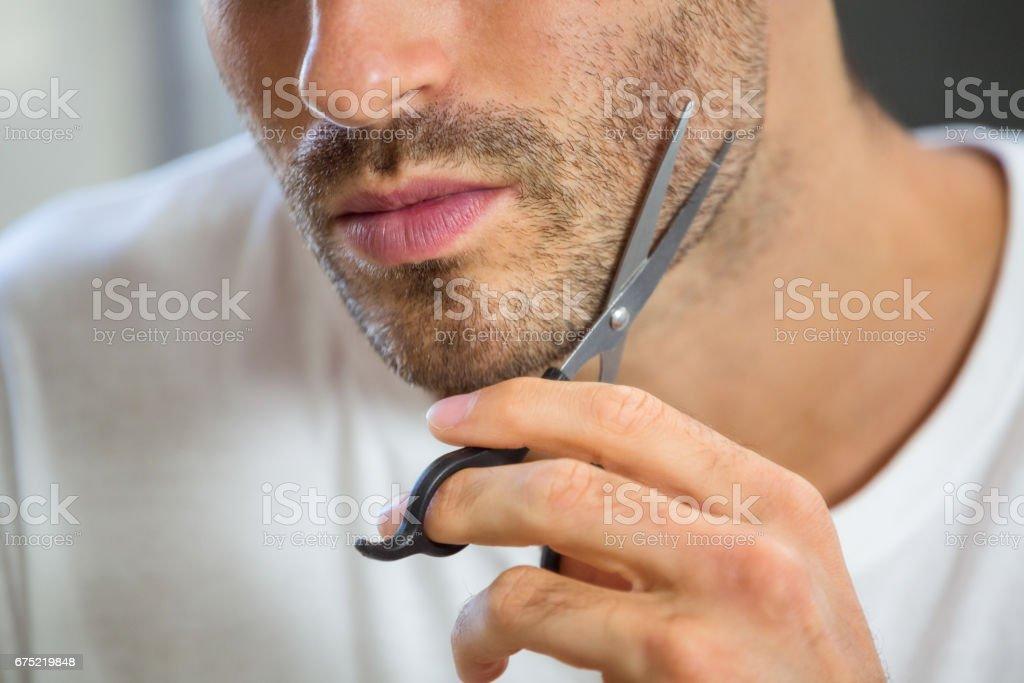 Man cutting beard royalty-free stock photo
