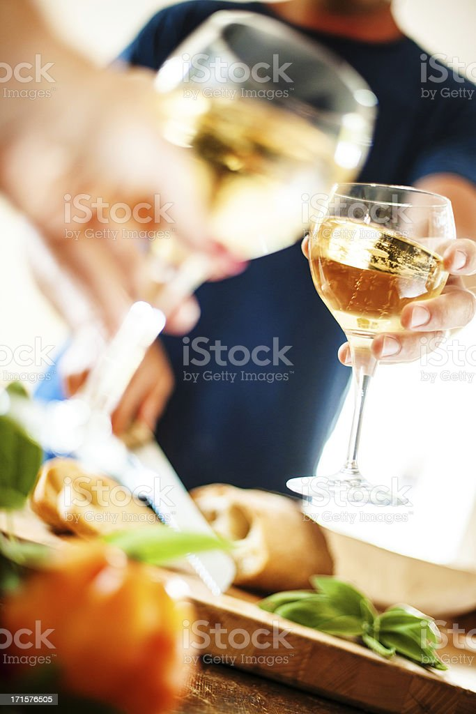 Man cutting bread and toasting royalty-free stock photo