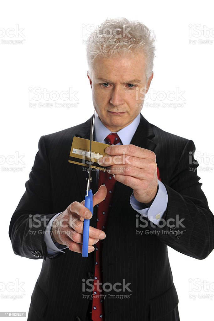 Man Cutting Credit Card royalty-free stock photo