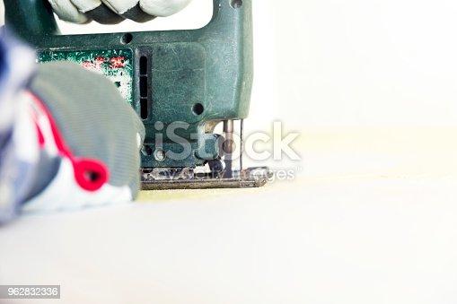 man cutting kitchen countertop using electric jigsaw home