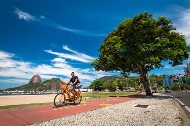 Man Cycling in Botafogo Beach stock photo