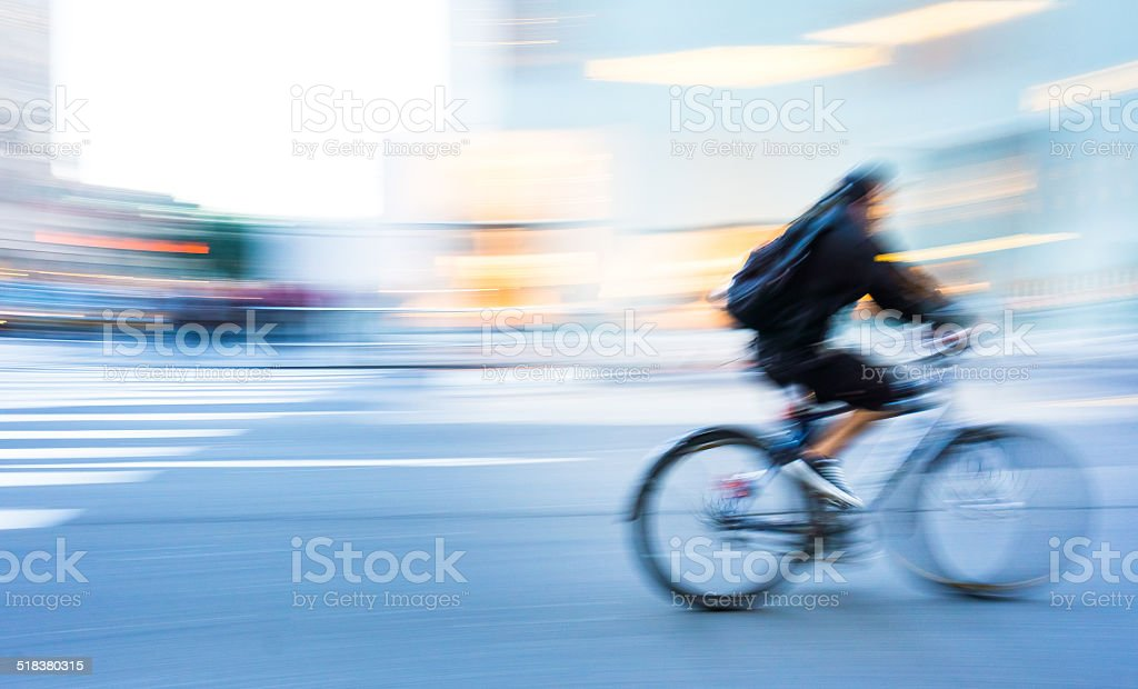 Man cycling in New York stock photo