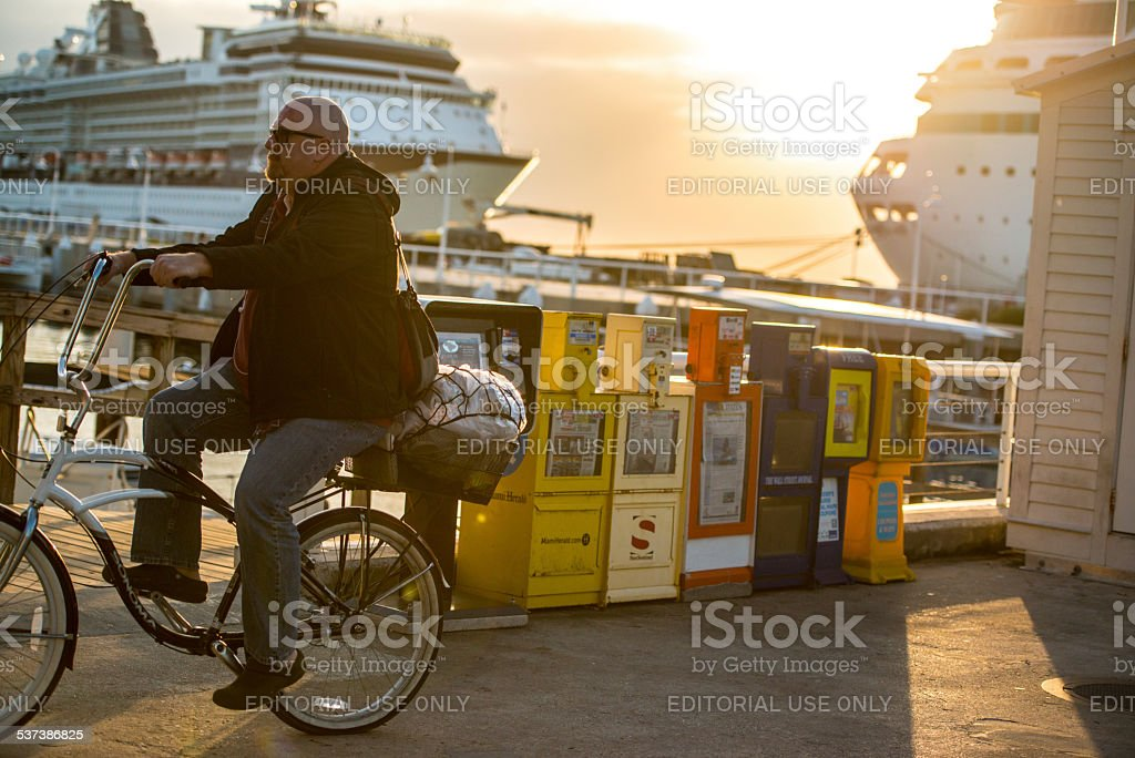 Man cycling in the evening, Key West stock photo