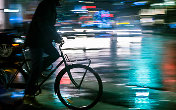 Man cycling in the night