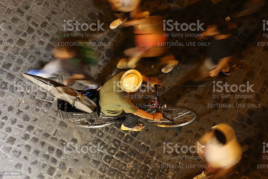 Man cycling in Trastevere, Rome stock photo