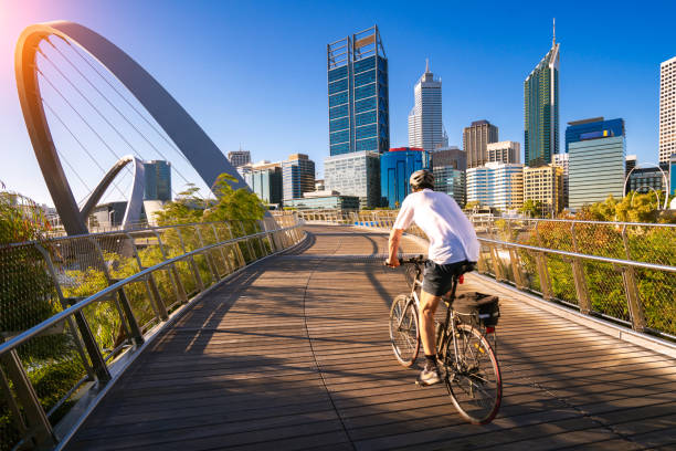 A man cycling on an elizabeth bridge in Perth city A man cycling on an elizabeth bridge in Perth city, western, Austrakia, this image can use for bike, sport, relax, healthy concept australia stock pictures, royalty-free photos & images