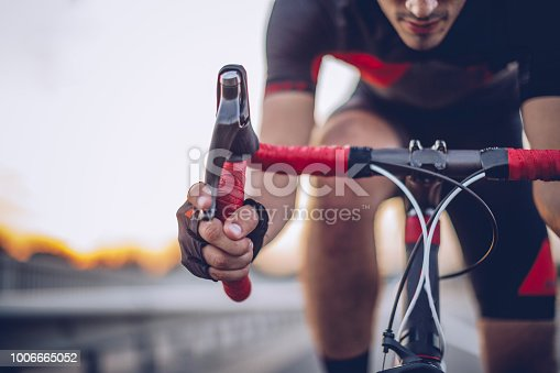 Athlete on racing bike outdoors